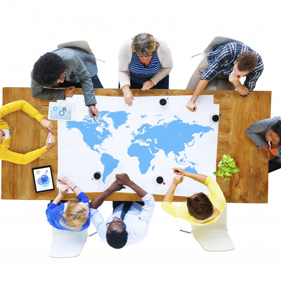 Group of Business People Meeting with World Map