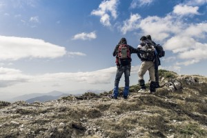 People hiking on top of a mountain in Filignano, Italy. By fabrizio Verrecchiaon unsplash
