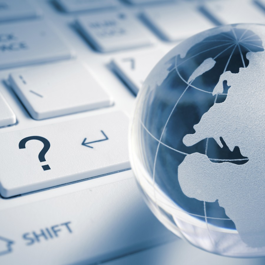 Question concept - Question mark with global earth (europe map) on enter Computer laptop Keyboard